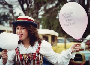 Celebrating with a twirl of fairy floss, and dressed in period costume, this happy participant enjoys the Special Open Day at Sutherland Homes on Sunday November 20, 1983
